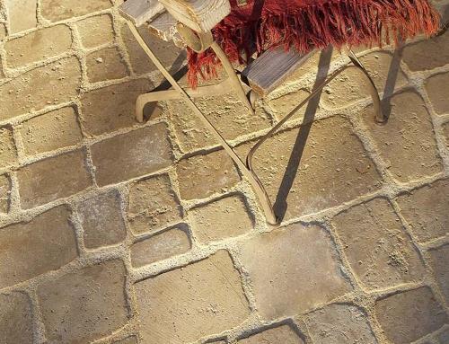 Réalisation d'une cour intérieure en pavés calcaire Romain